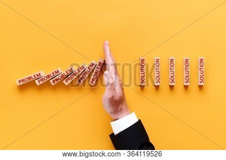 Problem, Solution - Inscriptions On Wooden Blocks. Male Hand Stops Falling Blocks, Flat Lay On Yello
