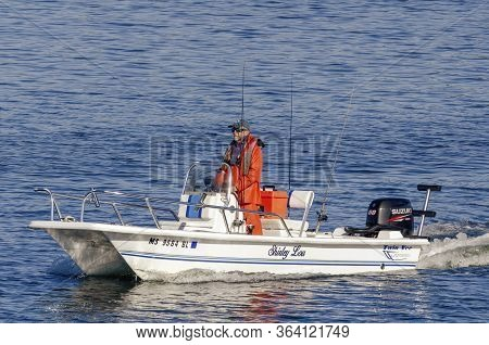 New Bedford, Massachusetts, Usa - April 29, 2020: Fisherman Piloting The Twin-hull Shirley Lou Out O