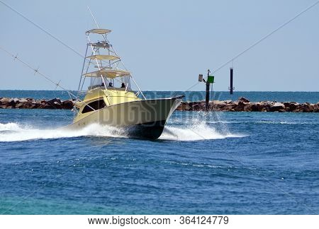 High-end Deep Sea Sport Fishing Boat Returning To Home Port After A Day At Sea.