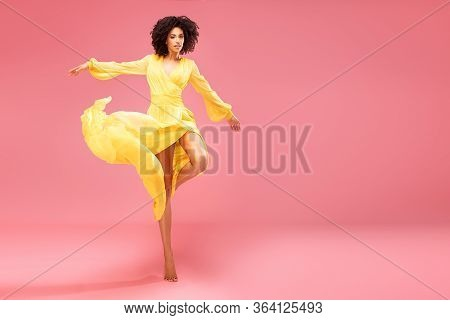 Afro Girl Dancing In Yellow Maxi Dress.