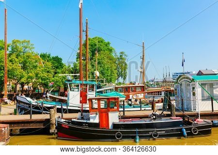 Fishing Boats In The Harbor Of Leer, Ostfriesland, Germany