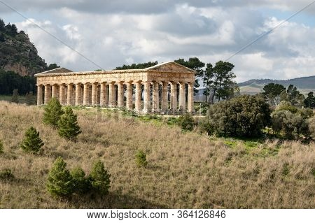 Landscape With Ancient Doric Temple Of Segesta In Sunny Spring Day With Slightly Cloudy Sky