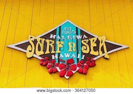 Haleiwa, Oahu, Hawaii - November 06, 2019: Surfer Sign On A House Wall In Haleiwa. Aloha Is The Comm