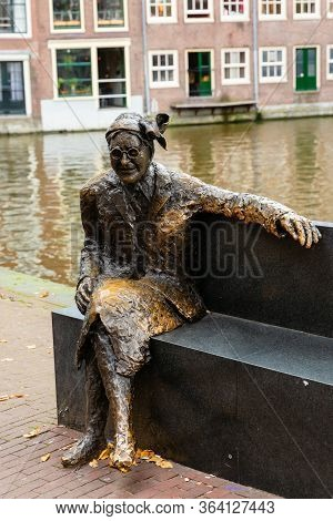 Bronze Sculpture At A Canal In Amsterdam, Netherlands
