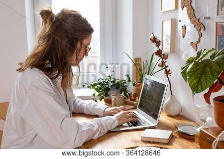 Young Woman Freelancer/designer Working On Computer From Home Office During Self-isolation Due To Co