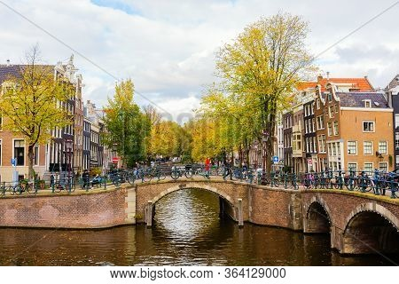Cityscape With Typical Canal In Amsterdam, Netherlands