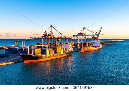 Loaded Cargo Merchant Ships/ Bulk Container Vessels Docked At Terminal Port/ Pier/ Wharf. Heavy Stee