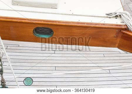 Wood Deck And Porthole Of An Old Wood Sailboat, Verdigris Patina, Copy Space, Horizontal Aspect
