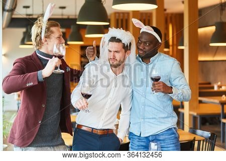 Three friends celebrate drunken bachelor party together and silly around