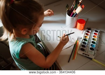 Child Painting By The Window With Paint. Creative Little Artist At Work. Toddler Crafts. School Kid