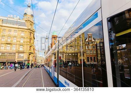 Street Scene With Streetcar In Amsterdam, Netherlands