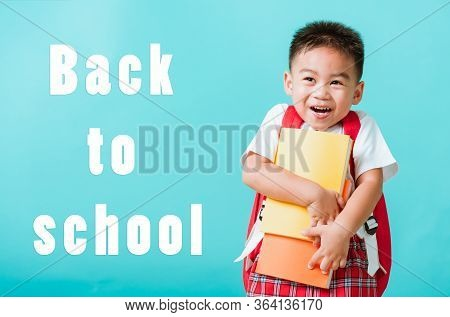 Back To School Concept. Portrait Asian Happy Funny Cute Little Child Boy Smiling And Laugh Hug Books