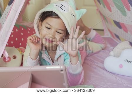Mixed Race Asian Girl Making Facetime Video Calling With Tablet At Home, Using Learning Online App,