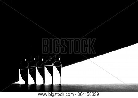 Medicine Ampoules On Black And White Geometric Background. High Contrast Image Of Ampoules.