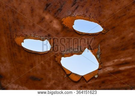 Rusty Metal Holes. Leaky Roof. Old Metal Red. The Consequences Of Corrosion