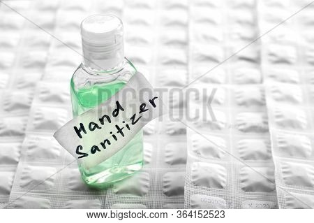 Antibacterial Alcohol-containing Hand Sanitizer In A Plastic Bottle. Hand Sanitizer On White Tablet