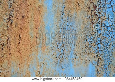 Metal Texture With Scratches And Cracks Copy Space. Cracked Blue Paint, Rusty Metal Surface. The Rus