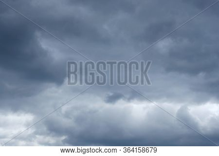 Gray Cloudy Sky. Clouds Overcast Sky Background. Abstract Background Time Before Rain With Thunder.