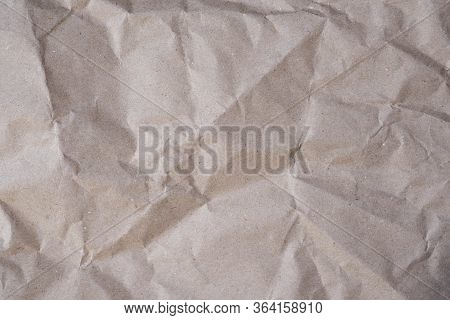 Gray Wrapping Paper Crumpled Background. Paper For Packaging Parcels Top View. Texture Of Crumpled S