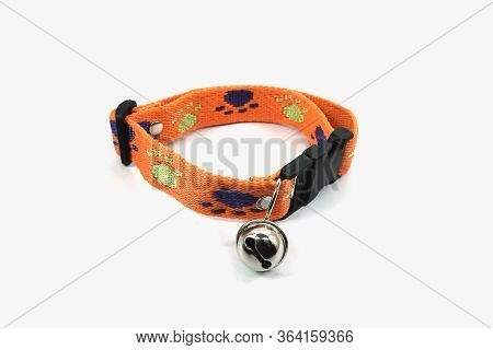 Orange Neck Collar With Dog Bell Isolated On White Background