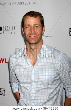 """LOS ANGELES - AUG 22:  Colin Ferguson arrives at the """"Lawless"""" LA Premiere at ArcLight Theaters on August 22, 2012 in Los Angeles, CA"""