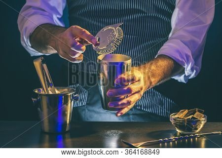 Bartender Preparing Cocktail In Shaker; Barman Getting Ready To Pour Finished Cocktail From Shaker I