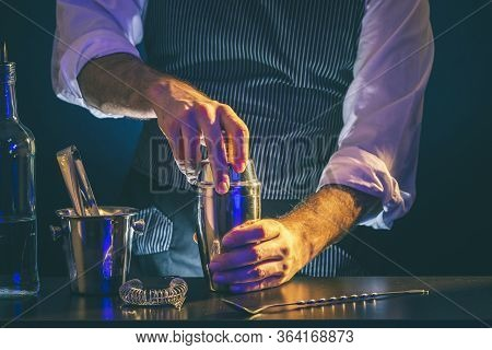 Bartender Making A Cocktail Using Cocktail Shaker; Barman Shaking Cocktail Ingredients In Cocktail S
