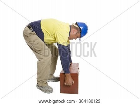 A Man Using A Poor Lifting Technique To Move His Tool Box. Safety Concept.