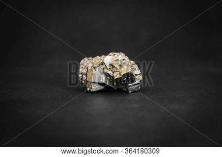 Pyrite Crystal On Black Background. Copy, Empty Space For Text