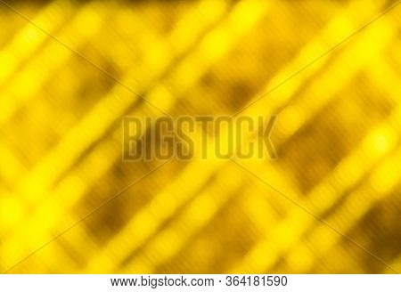 Abstract Yellow Blurred Background With Bokeh Circles.