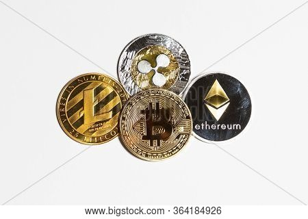 Cryptocurrency Bitcoin Btc, Litecoin, Ripple And Ethereum Isolated On White Backgorund