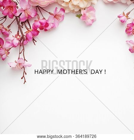 mothers day. pink rose flowers on white background. shabby chic colors