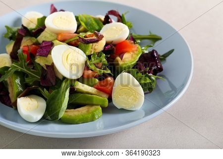 Egg, Avocado, Cucumber And Tomato Salad Served On Plate