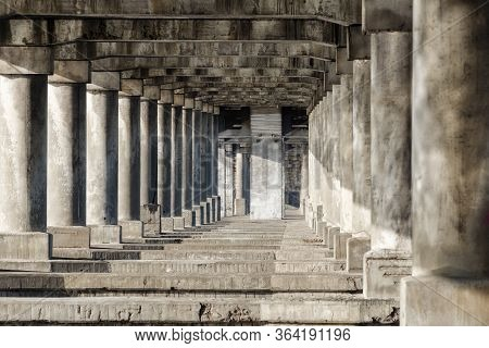 Antique Colonnade. Stone Pillars And Stairs. Ancient Colonnade.