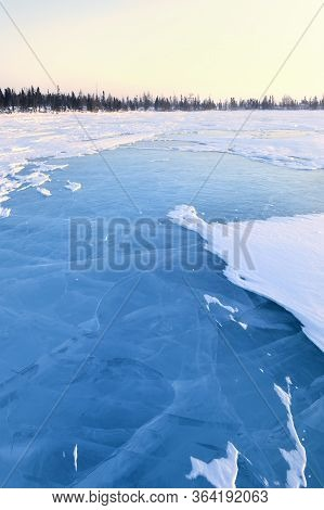 Frozen Lake With Boreal Forest (taiga) And Tundra In Background At Wapusk National Park, Canada, Dur