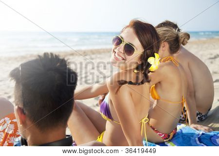 group of young people enjoying the beach