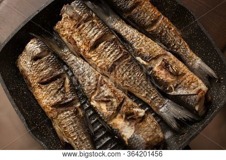 Grilled Spicy Fish On Desk. Roasty Fish Concept.