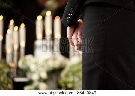 Religion, death and dolor  - woman at urn funeral mourning the death of a loved person
