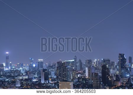 Bangkok City Scape At Night In Blue Tone With Top Copy Space For Your Decide.