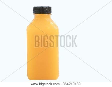 Orange Juice In Small Plastic Shaped Bottle