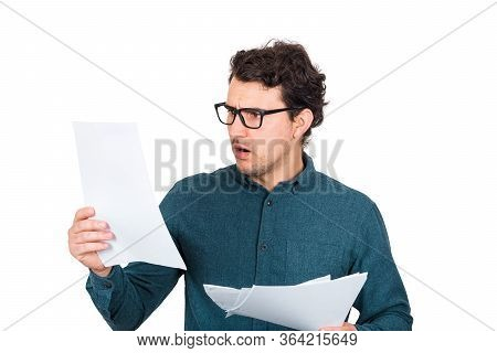 Perplexed Businessman Looking Stunned At Paper Documents Isolated On White Background. Confused Busi