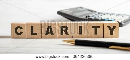 The Word Clarity Written On Wooden Cubes. Business Concept