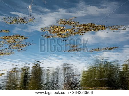Inverted Reflection Of Beautiful Blue Sky And Sun,andover,england,united Kingdom.