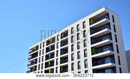 New Contemporary Residential Building Exterior In The Daylight. Modern Apartment Buildings On A Sunn