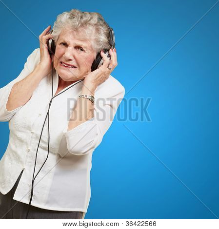 Angry Woman Clenching Her Teeth On Blue Background