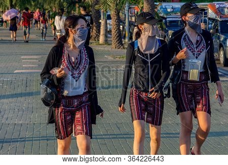 Pattaya,thailand - April 17,2019:beach Road Three Young Chinese Women With Face Masks Were Doing A S