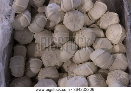 Frozen Manti Dumplings Sold By Weight In A Refrigerator Container On A Store Counter