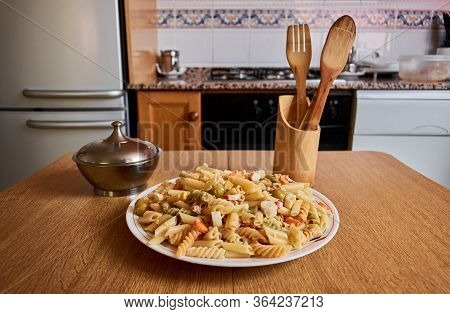 Table In A Kitchen With A Pasta Salad On It. Mediterranean Homemade Recipes