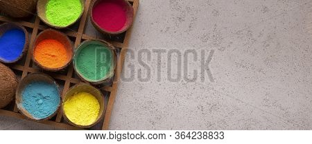 Multicolour Powder In Coconut Peels In Stand For Holi Holiday