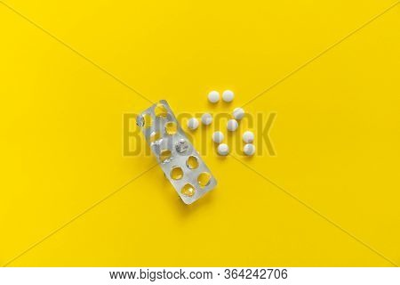 Top View On The Pills Removed From The Pack. White Pills On Yellow Background. Medicine, Medication,